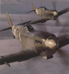 Spitfire duo.  Roger's real father, Jerry MacKenzie, was a Spitfire pilot during WWII.