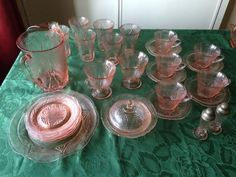 VINTAGE DEPRESSION GLASS ROYAL LACE SET PINK HAZEL ATLAS (£30 to £50) - A comprehensive set if vintage depression glass royal lace hazel atlas pattern in pink, comprising multiple pieces including a pair of salt and pepper cruets, various cups saucers, tumblers, dishes etc all in good order.