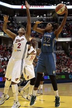 Minnesota Lynx forward Rebekkah Brunson (32) shoots over Indiana Fever forward Erlana Larkins in the second half of Game 3 of the WNBA basketball Finals, Friday, Oct. 19, 2012, in Indianapolis. The Fever won 76-59. (AP Photo/AJ Mast)