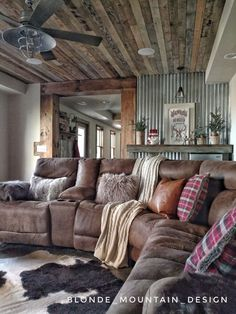 Rustic basement, mancave, wood ceiling, barnwood, cozy basement, cowhide rug, cabin cozy, fur and leather, corrugated metal wall, winter hideaway, media room, winter family room #CowhideRugs