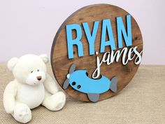 Custom circle wood sign for a baby boy nursery. Personalize your baby's name on this round woode