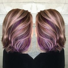 She wanted to completely change her look and add pretty pops of purple. We chose warm golds and Browns as a complete opposite from the ashy blonde she came in as.