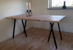 Plank table made ​​of Douglas planks from http://www.nyfillerupsavvaerk.dk/  Table legs from Hay http://hayshop.dk/products/98-dining-tables/21-loop-stand-frame/