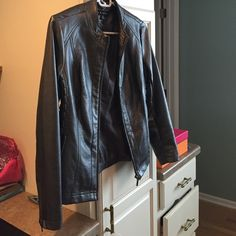 Silver leather jacket Cute jacket with detailing on side- silver/ dark grey color- very gently used Tribal Jackets & Coats