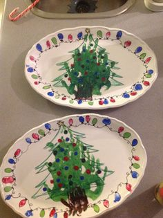 Purchased enamel paint from Michael's, and platters from Superstore. Hand print tree, outlines via Sharpie markers. Thumb print lights, outlined with Sharpies. Ornaments are thumb prints. Dry for hour, place in oven, heat to 350*, bake for 1/2 hour. Voila! Christmas print DIY plate, great gift for grandparents.
