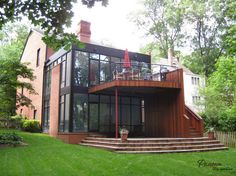 http://www.drissimm.com/wp-content/uploads/2015/07/Astounding-brick-home-with-wooden-deck-and-green-courtyard.jpg