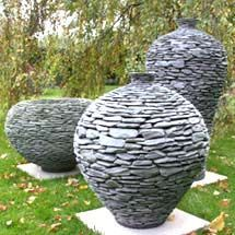 This artist creates these sculptures and also makes them into operating fountains...call me crazy, but I feel like I could pull this off myself with all of the slate available in this area.