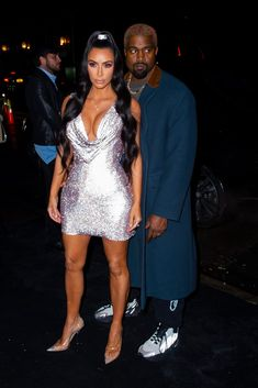 2a1ca90b1935cd Kim Kardashian and Kanye West Steam Up the Versace Show Like Only They Can