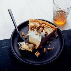 Tiramisu Icebox Pie | Pastaria's Mathew Rice reengineers the classic tiramisu into this Tiramisu Icebox Pie, with a crispy ladyfinger crust, coffee mousse, and salty-sweet cookie crumble. Get the recipe at Food & Wine.