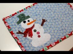 Great Tutorial for a beginner, this will show you some of the basics.  Frosty the Snowman Mug Rug - DIY Tutorial