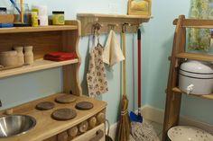 Amazing Montessori play kitchen with apron, broom, washrag, etc.