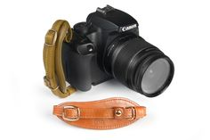 Ciesta camera hand strap. It fits securely in your hand and is also perfect for when you use a tripod. It doesn't get in the way of your shot, unlike neck straps!