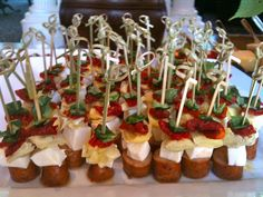 Anti-pasta skewers - spicy sausage, fresh mozzarella, marinated artichokes, sun dried tomatoes and fresh basil.