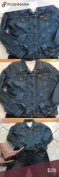EUC NEVER WORN LEVI STRAUSS BLUE JEAN JACKET ABSOLUTELY LOVE THE STYLE ON THIS VINTAGE LEVI STRAUSS JACKET . MY FAVORITE PART IS THE SIDE POCKETS AT WAIST LEVEL THAT YOU CAN ACTUALLY GET INTO AND PUT STUFF IN!! STITCHING IS UNIQUE! BLUE JEAN JACKETS COST AN ARM AND A LEG THESE DAYS BUT NOT THIS ONE !! SO WELL PRICED Signature by Levi Strauss Jackets & Coats Jean Jackets