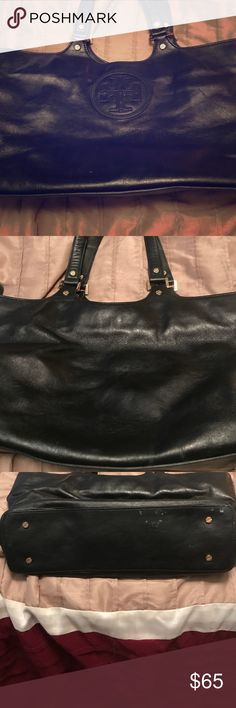 Tory burch bag in fair condition had a ink marks Tory black bag with handles to carry around in fair shape and inside on left side had a pen bust inside but in corner and can only see if your inside, outside is in good condition.  Measurements are. 17 wide by 10 height. Tory Burch Bags Mini Bags
