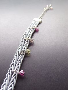 Accessories Bracelet   -Blue gray -The Swarovski bead was attached to the string of silk and it was made the bracelet.