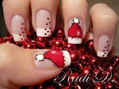 Check out this wonderful Santa hat nail art. Be creative and paint on Santa hat French tips on your nails with stencil embellishments as cascading Christmas balls.