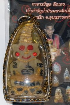 """nice Jolly bone Phra Ngang amulet by AJarn Poon - This great, cheerful Phra Ngang """"Red Eyes"""" from Ajarn Poon has a wonderful feel to it, featuring a carved bone """"underworld Buddha"""" with an impish smil... #amulets #occult #Thailand"""