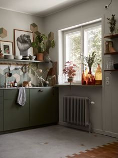 This kitchen just has so much character. I love the muted green cabinet doors with… Kitchen Renovation Design, Kitchen Design, Green Kitchen, Kitchen Decor, Kitchen Ideas, Scandinavian Apartment, Green Cabinets, Interior Decorating, Interior Design