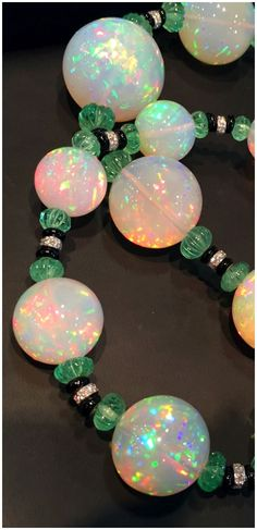 A spectacular David Webb necklace with huge Ethiopian opals,  carved emerald beads, onyx, and diamonds. At John T Haynes.