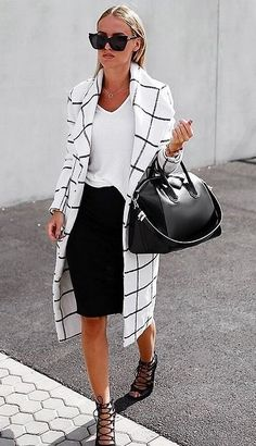 A graphic coat, black skirt, and white tee.