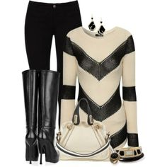 Striped knitted long sweater with black high heeled boots.