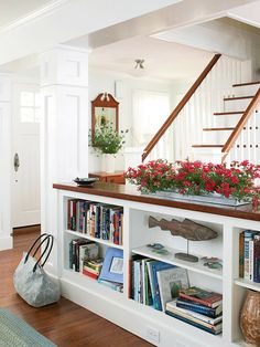 I love the idea of a short bookshelf to divide a room without closing it in.  Plus, it gives you some display space on top! Great use of space!