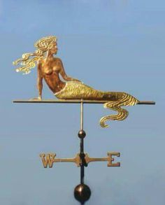 Mermaid with Wavy Tail Weather Vane by West Coast Weather Vanes. Much like Sirens, mermaids in stories would sometimes sing to sailors and enchant them, distracting them from their work and causing them to walk off the deck or cause shipwrecks. Real Mermaids, Mermaids And Mermen, Sirens, Georges Chelon, West Coast Weather, Weather Vanes, Cottages By The Sea, Merfolk, Mermaid Art