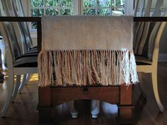 Burlap table runner!  I would love a bedskirt made this way!