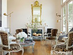 house beautiful neutral living room decor leopard chairs