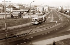1970-es évek eleje, Nagyszőllős út. Az út nevének írása még így volt szabályos. A manapság itt látható benzinkút még persze sehol. Az ostorlámpák viszont már itt vannak.A kép főszereplője egy 72-es járatszámú Ikarus 180-as.A