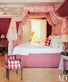 A Swedish-style bedroom in a home by John Stefanidis features a circa-1900 French tub chair and a fanciful canopy.