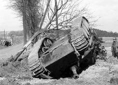 A blown upside down German Jagdpanther tank destroyer after an air attack near Altenkirchen, Germany, 1945.
