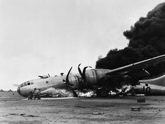 July 9, 1945: A B-29 burns furiously after an emergency landing on Iwo Jima, while returning from a raid on the Japanese Mainland. Army Air Forces caption says the plane was badly shot up on the raid damaging the plane's hydraulics resulting in the bad landing.