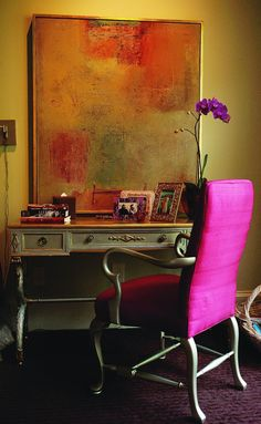 I love the painting, and I can't help but love the fuchsia silk chair.