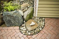 Rain Chain into rain catchment pebble fountain - eclectic - landscape - boston - Natalie DeNormandie