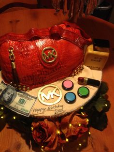 - Purse cake, michael Kors purse, michael kors handbag, amazing cake, unique cake, fondant lipstick, 21st birthday cake, brides cake, baby shower cake, designer cake