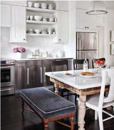 Love this kitchen... especially the vinatge table resurfaced in marble & that darling bench