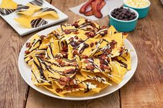 Create the tastiest Chocolate & Bacon Explosion, Tostitos® own Chocolate & Bacon Recipe with step-by-step instructions. Make the best Chocolate & Bacon Explosion for any occasion.