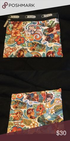 Lesportsac small pouch 🌺🌟MOVING SALE🌟🌺 Lesportsac Hawaiian exclusive print by a local artist. This is a small pouch. LeSportsac Bags Cosmetic Bags & Cases