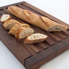 Handcrafted reversible walnut wood bread board