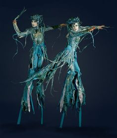 Fabulously textural stilt costumes! I love the way the lines of the body are blurred