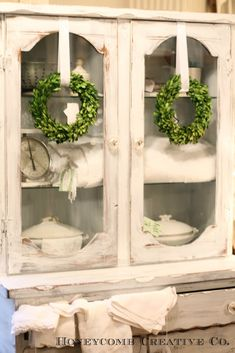 small wreaths hanging in glass office doors Decor, Christmas Home, Painted Furniture, Country Decor, French Country Christmas, Country Cottage, Cabinet Decor, Cottage Christmas, China Cabinet Display