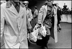 Bruce Davidson  USA. Brooklyn, New York City. 1964. A demonstrator is carried away by police during a rally by the Congress of Racial Equality (CORE).  Image Reference  NYC32304