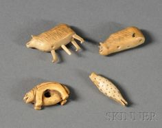 Inuit ivory effigy carvings.