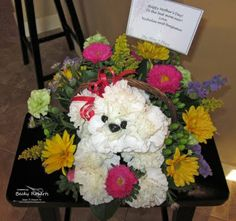 OMG adorable dog flower arrangement made with carnations, would be cute with  hydrangeas too though, and other assorted flowers!