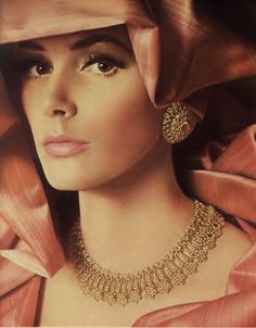 Elegantly gorgeous gold filigree 1960s jewelry. Vintage fashion. Quite stunning. I think the hair and dress will dictate the jewelry.