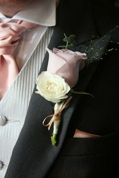 Each Boutonniere used a different shade of Nude Rose with a little Floribunda Rose Bud