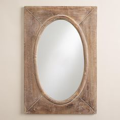 Our handcrafted mirror features an oval mirror laid in a rectangular wood profile with a burnished natural finish for a rustic appeal.