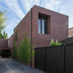 B.E.+Architecture+completes+a+trio+of+red+brick+houses+for+the+same+family